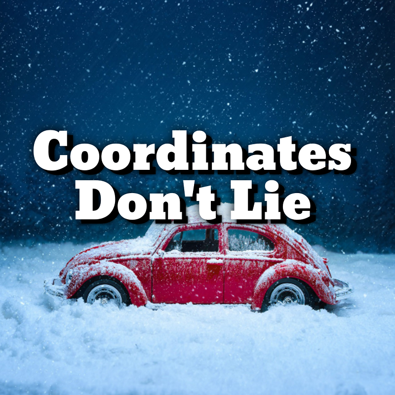 Coordinates Don't LIe; A vintage red Volkswagen bug sits in a snowy scene.