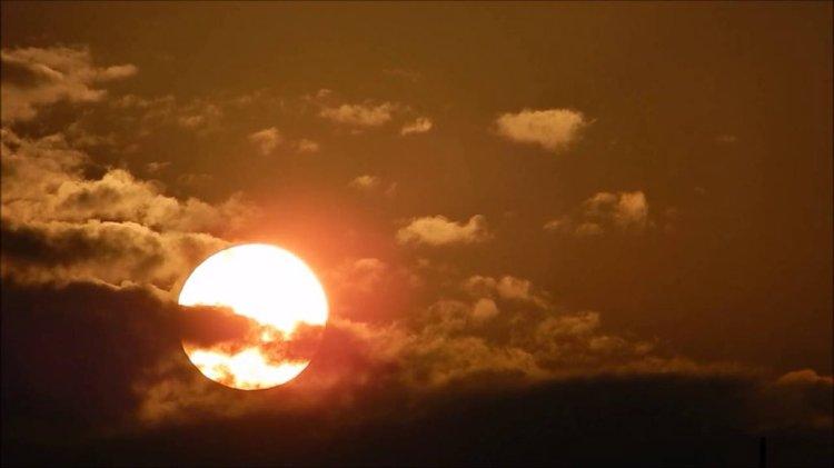 clouds behind sun